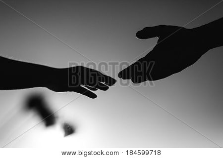 Close up black and white picture of two hands male and female