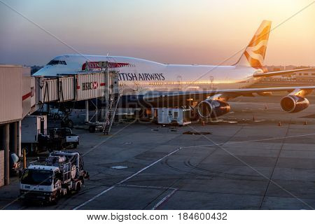 Heathrow Airport, London, England - JULY 28 2016: British Airways jet getting ready to load passengers at Europes busiest airport at sunset.