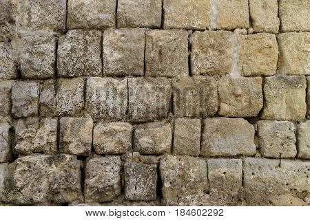 rustic ancient handcrafted stone wall in Matera italy.