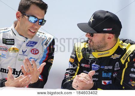 April 30, 2017 - Richmond, Virginia, USA: Paul Menard (27) and Aric Almirola (43) head to their cars for the Toyota Owners 400 at Richmond International Speedway in Richmond, Virginia.