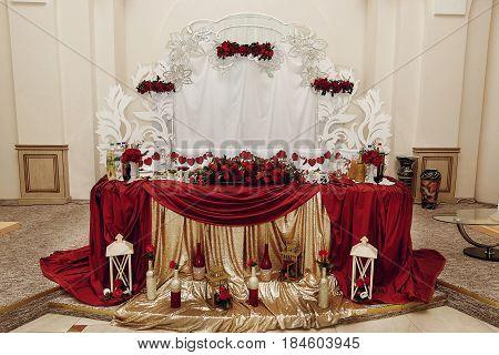 Stylish Centerpiece Table For Bride And Groom With Red Golden Decor, Luxury Decorated Place For Wedd