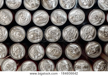 metallic cans top view. pattern can from beer or soda flat lay. steel background. recycling concept. drink bar at wedding reception