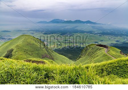 View Of Aso Volcano Mountain And Farmer Village From Hill Top In Kumamoto, Kyushu, Japan