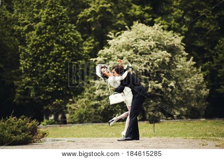Funny Picture Of A Groom Cathing Bride In The Park