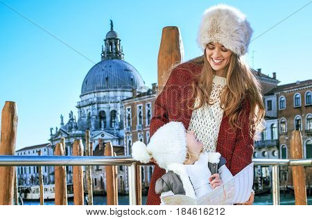 Mother And Child Travellers In Venice, Italy In Winter With Map