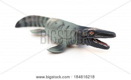 a Mosasaurus toy on white background horizontal