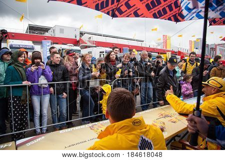 Moscow, Russia - 12 June 2016: world championship WTCC at the Moscow Raceway. Fans greet riders before the autograph session command Lada Sport Rosneft
