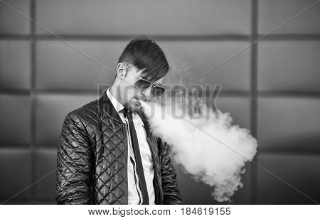 Vape Man. Portrait Of A Handsome Young White Guy With Modern Haircut In Aviator Sunglasses Vaping An