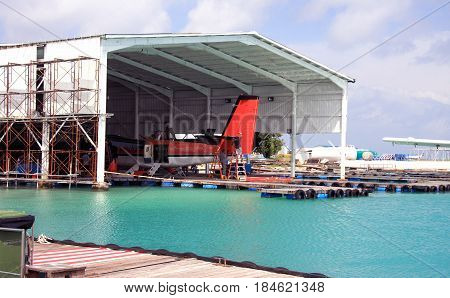 Maldives. A seaplane in a repair dock in port.