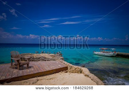 COZUMEL, MEXICO - MARCH 23, 2017: Beautiful vacation in Cozumel with natural view, yachts, gorgeous blue ocean and sky with some seagulls.