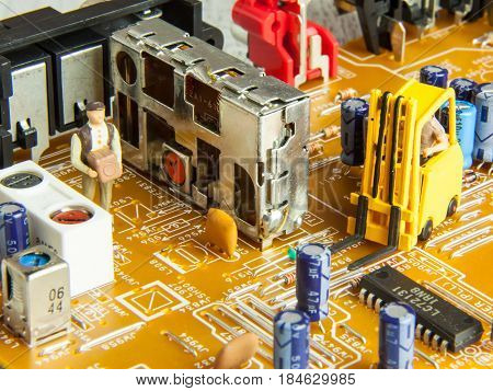 Printed circuit board with figurine of working man detail