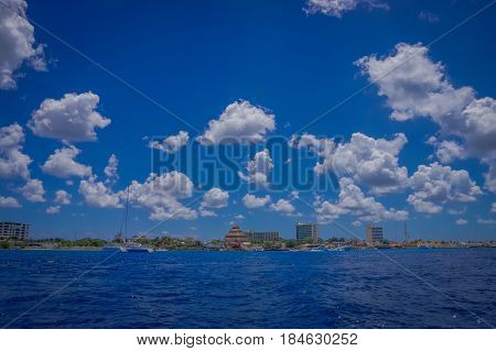 Beautiful attraction of Cozumel with some natural buildings and yachts, gorgeous blue ocean and sky.