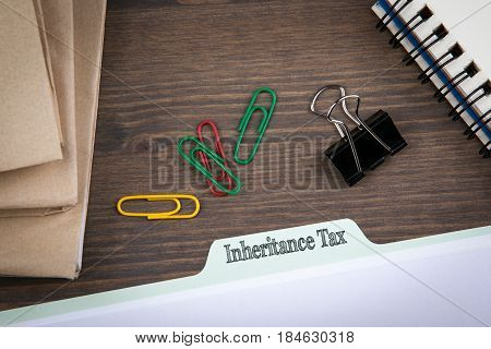Inheritance Tax. Folder Register on a dark wooden desk.