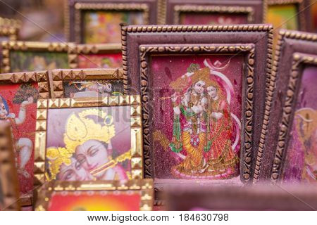 Vrindavan, India - March 17, 2016: Krishna picture covered by colorful powder during Holi celebration in India