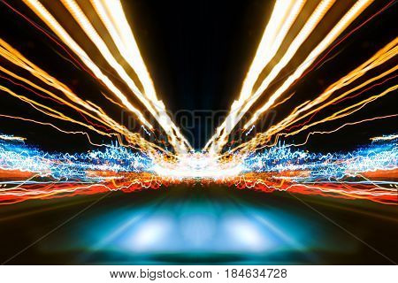 Abstract image of Long exposure night traffic light in the city. Street Night light : inside car view