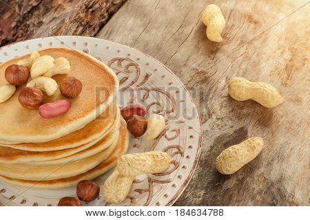 Stack Of Hot Pancakes With Nuts On The Plate