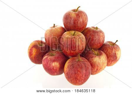 pyramid red apples isolated over white background