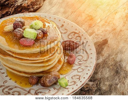 Stack Of Hot Pancakes With Nuts, Dried Fruits And Caramel Syrup.