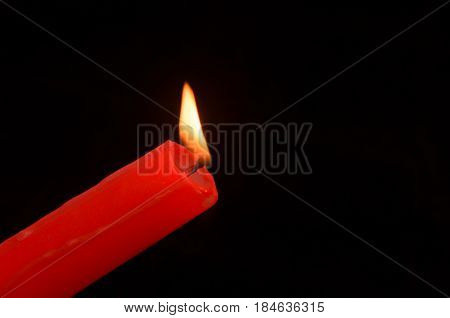 Matches with multi-colored heads burn and do not burn. Lighting the candle.