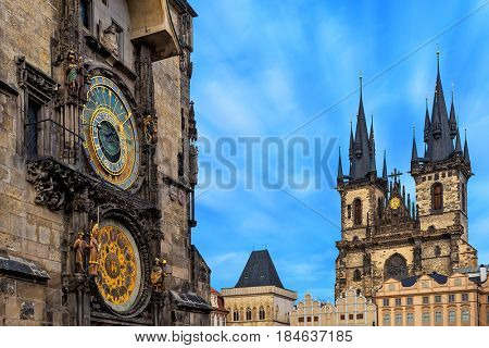 Famous astronomical clock and Church of Our Lady before Tyn on background in Prague, Czech Republic.