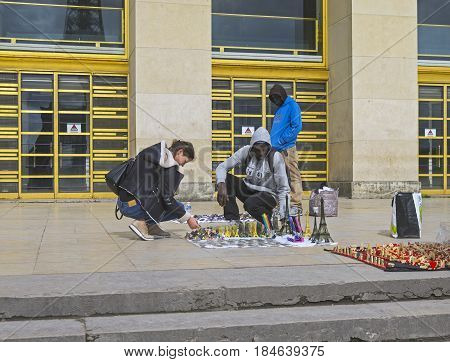 PARIS FRANCE - APRIL 1 2017: Illegal street souvenir trade in Paris France.