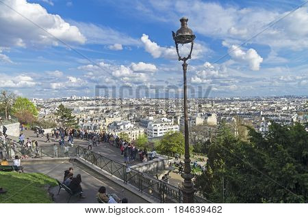 PARIS FRANCE - APRIL 1 2017: View from the hill of Montmartre to the north-eastern part of Paris. A sunny evening in early April.