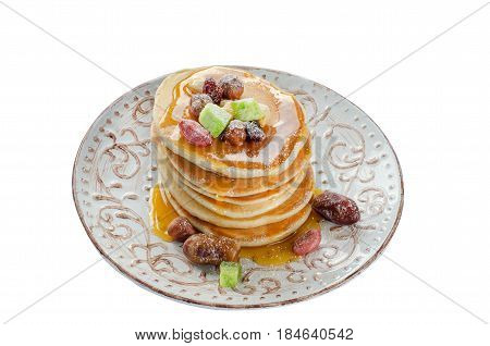 Isolated Stack Of Hot Pancakes With Nuts, Dried Fruits And Caramel Syrup.