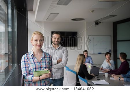 two business people preparing for next meeting and discussing ideas by the window