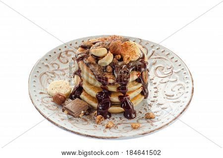 Stack Of Hot Pancakes With Nuts, Bananas And Chocolate Syrup. Isolated