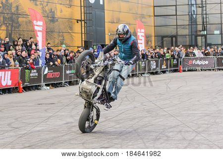 St. Petersburg Russia - 15 April, Motoshow in front of the audience,15 April, 2017. International Motor Show IMIS-2017 in Expoforurum. Sports motorcycle show of bikers on the open area.