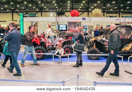 St. Petersburg Russia - 15 April, People are photographed at the motor depot,15 April, 2017. International Motor Show IMIS-2017 in Expoforurum. Visitors and participants of the annual moto-salon in St. Petersburg