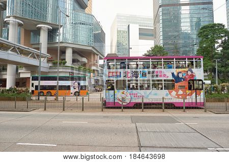 HONG KONG - CIRCA DECEMBER, 2015: double-decker tramway covered with overall advertising livery.