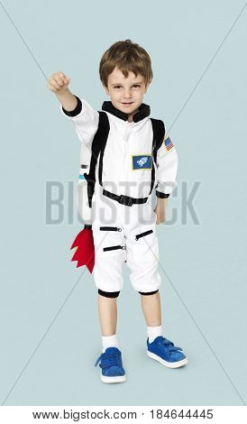 Little boy with astronaut dream job smiling