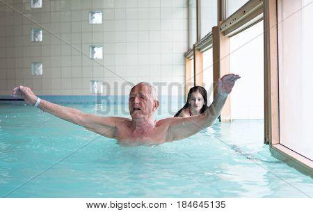 Senior Man In Swimming Pool