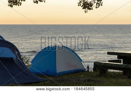 Tents on the beach after sunset on summer.