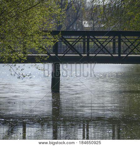 Bridge In A City Park Recletced In A Lake