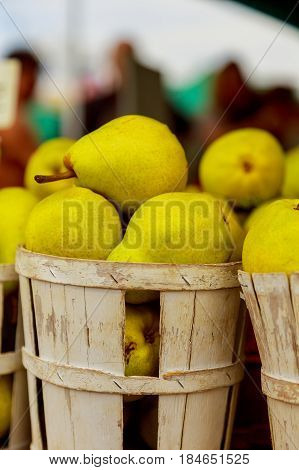 Selling Pears In Baskets At The Farmer's Market