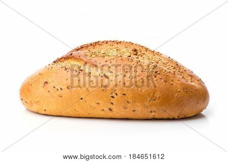 Loaf of white bread with sesame seeds over white background