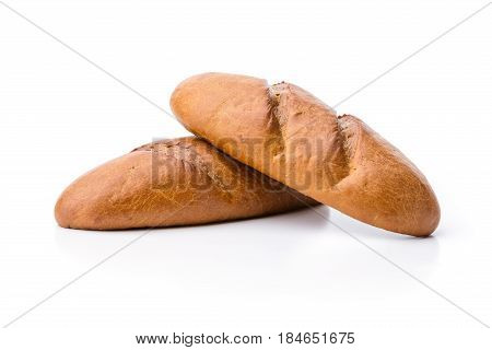 Loaves of white bread over white background