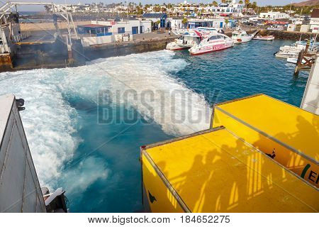 Playa Blanca, Lanzarote, 01 April, 2017: Top View Of Vehicle And Passenger Ferry.  The Ferry Runs Se