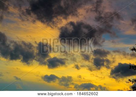 Cumulus Sunset Clouds With Sun Setting Down