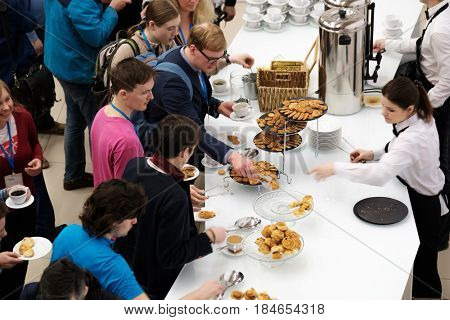 Moscow, Russia - April 15, 2017: Visitors have a lunch in a cafe at coffee break at Velocongress. Fast speed time lapse