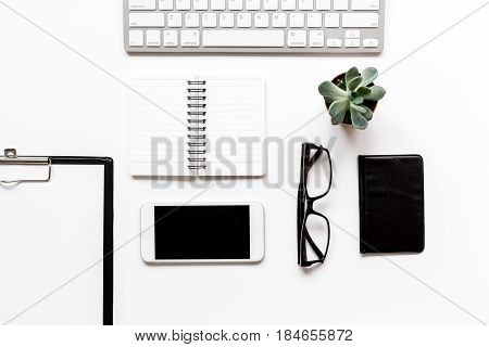 Modern office table with keyboard, mobile phone, notebook on white background top view mock-up