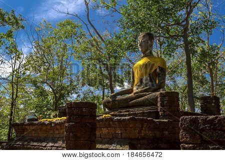 Wat Khao Phanom Phloeng and stature buddha with clear sky in Sisatchanalai Historical Park Sukhothai province Thailand