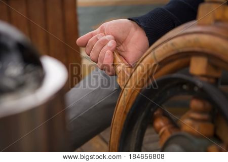 Man Driving A Boat, Wooden Helm