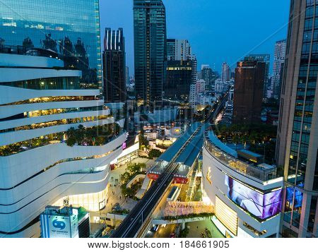 Bangkok Thailand - May 1 2017: Aerial shot of The Emporium and Emquartier Department Store in Bangkok Thailand at night time. The place is called The EM District in Bangkok with the Emporium and the EmSphere.