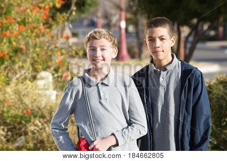 Pair Of Teen Male Students Outside