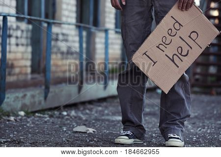 Poor man begging for help on the street