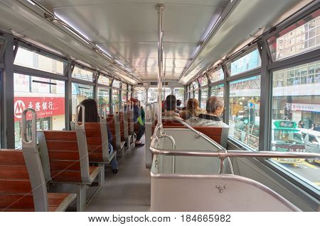 HONG KONG - CIRCA DECEMBER, 2015: inside double-decker tram. Hong Kong Tramways is one of the earliest forms of public transport in the metropolis.