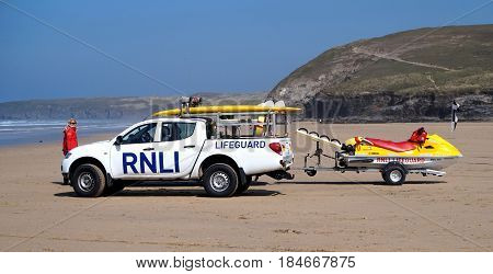 Newquay, Cornwall, Uk - August 7 2017: Rnli Lifeguard With Truck And Jetski On A Cornish Surfing Bea